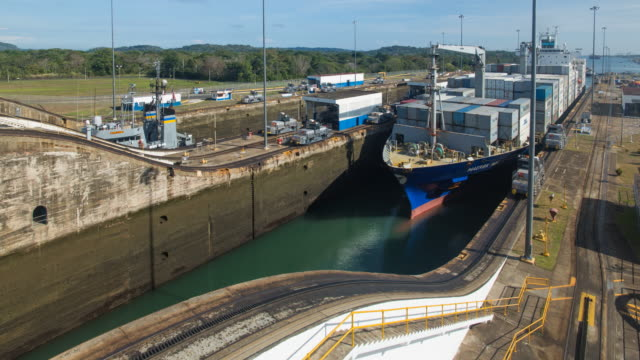 panama, container ship transiting the  miraflores locks on the panama canal - canal stock videos & royalty-free footage