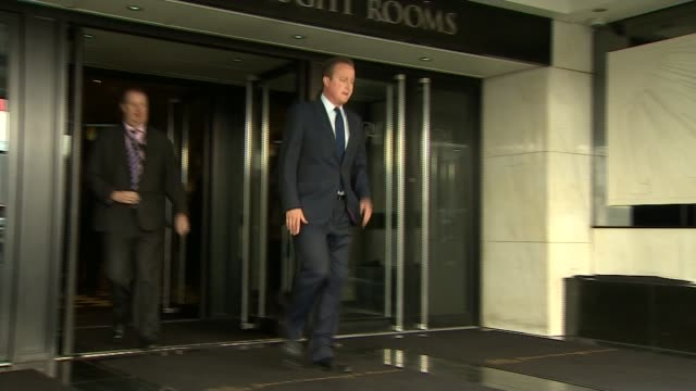 David Cameron publishes six years of tax returns Grand Connaught Rooms EXT Cameron out of building down steps past reporters and into car