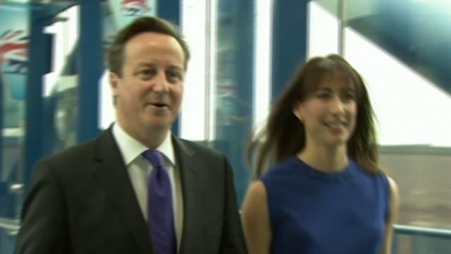 David Cameron publishes six years of tax returns LIB ENGLAND Birmingham INT David Cameron and wife Samantha Cameron along walkway as arriving at...