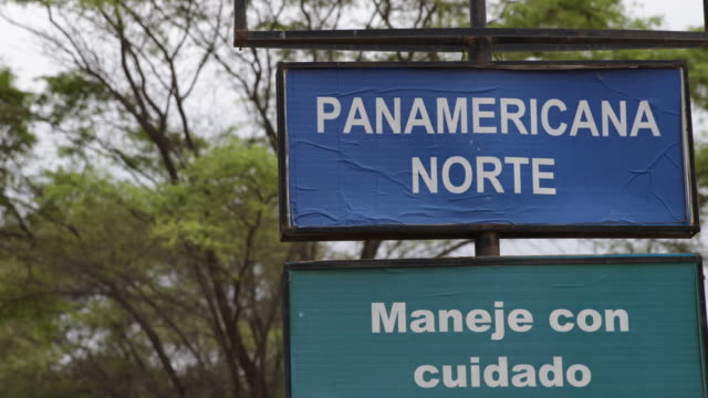 panamerican highway sign at the road the spanish warning says drive safely the panamerican highway links almost all of the mainland countries of the... - pan american highway stock videos & royalty-free footage