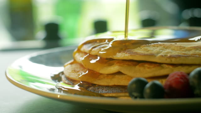pancakes & syrup - stack of plates stock videos & royalty-free footage