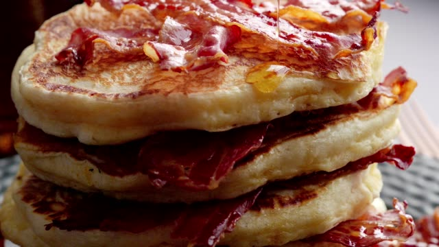pancakes with crispy bacon and maple syrup - pancake stock videos & royalty-free footage