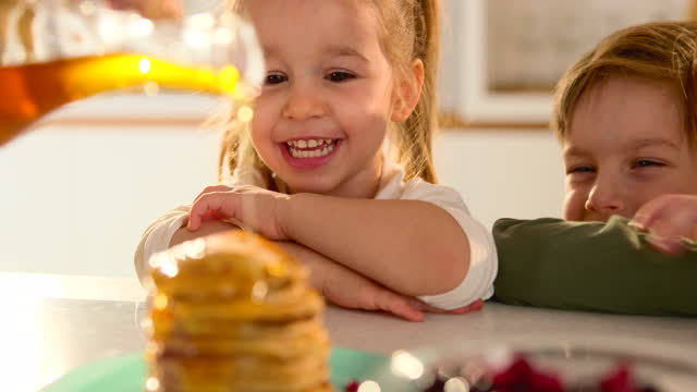 pancakes with honey for happy kids! - french food stock videos & royalty-free footage