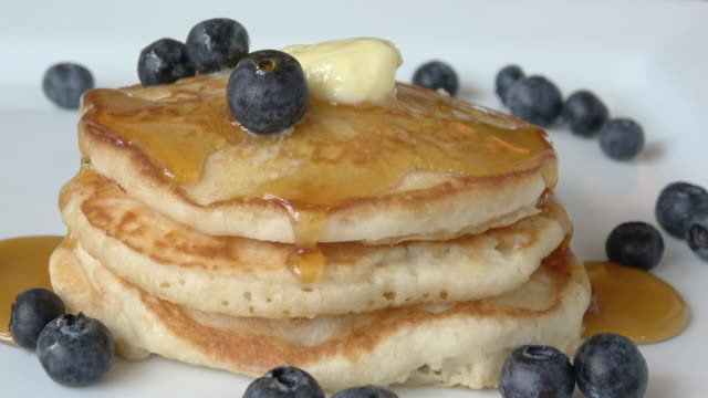 pancakes with maple syrup and blueberries - pancake stock videos & royalty-free footage