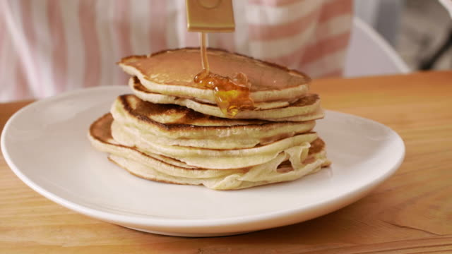 pancakes with maple syrup, katowice, poland - maple syrup stock videos & royalty-free footage