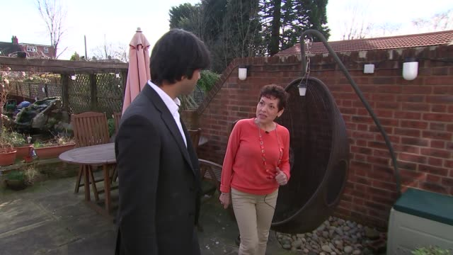 ext hannah mcneil along in garden with reporter sot mcneil sitting reading in house hannah mcneil interview sot her reaction to diagnosis in shock... - pancreatic cancer stock videos and b-roll footage