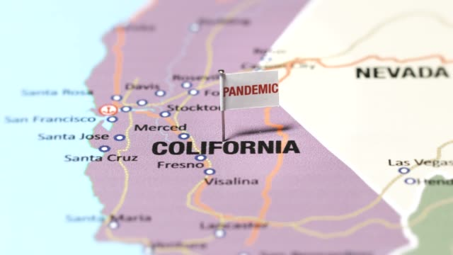 pandemic flag on colifornia - pinning stock videos & royalty-free footage