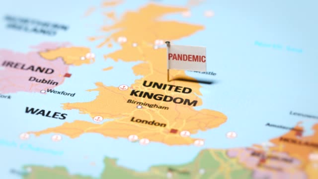 pandemic flag on united kingdom - west direction stock videos & royalty-free footage
