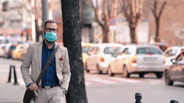 covid-19 pandemic - pollution mask stock videos & royalty-free footage