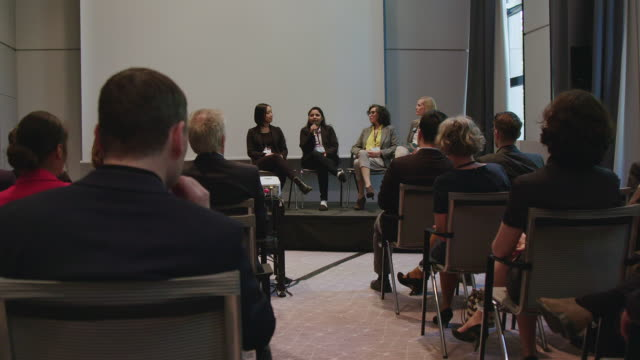 panel of female experts explaining during seminar - auditorium stock videos & royalty-free footage