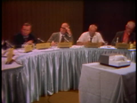 panel of journalists listen to the voice of howard hughes during a conference call about alleged biographer clifford irving. - ハワード ヒューズ点の映像素材/bロール