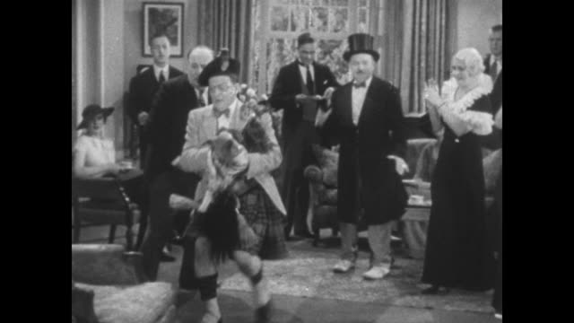 1934 panicked man gives pet pig to party guests who angrily pass him around - exchanging stock videos & royalty-free footage