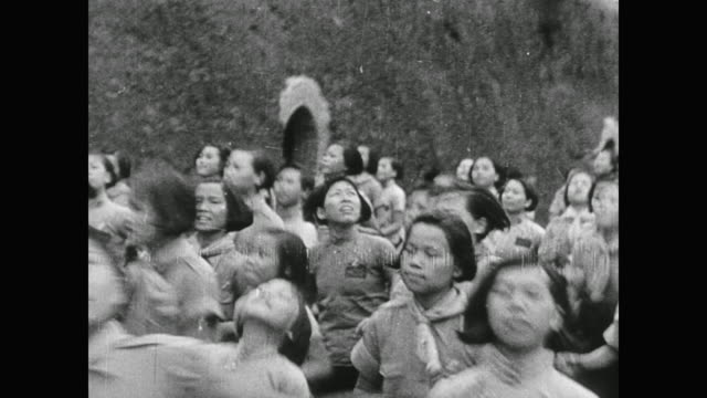 wwii panicked school children run to cave shelters as the air raid sirens go off in chongqing and japanese bombers appear in the sky - anno 1938 video stock e b–roll