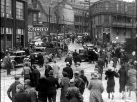 panicking crowd running down muddy street after rumor of a dam break / cars in traffic on muddy city street during flood johnstown floods on march 17... - crowd running scared stock videos & royalty-free footage