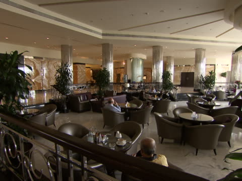 panleft across restaurant in the lobby of the intercontinental hotel - intercontinental hotels group stock videos & royalty-free footage