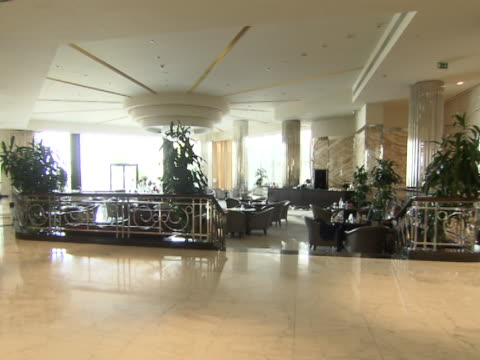 panleft across the lobby and the restaurant in the intercontinental hotel - intercontinental hotels group stock videos & royalty-free footage