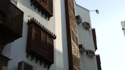 pan-left across wooden latticed screens covering windows, in al-balad, the historic centre of the city of jeddah . - jiddah stock videos & royalty-free footage