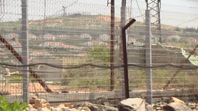 pan-left along the border fence aka as fatima gate, between lebanon and israel. the crossing was closed after israel's withdrawal from occupied... - israeli military stock videos & royalty-free footage