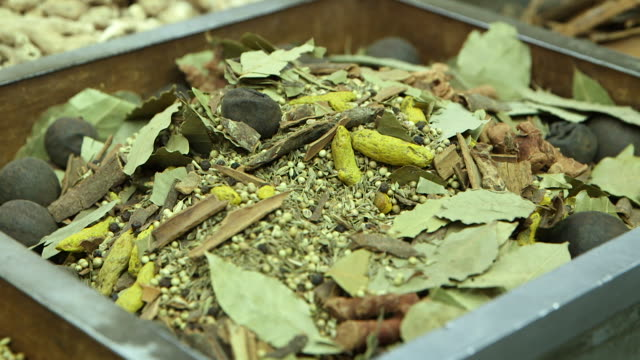 panleft from a heap of coriander seeds bay leaves cinnamon sticks and turmeric to dried ginger - coriander stock videos & royalty-free footage