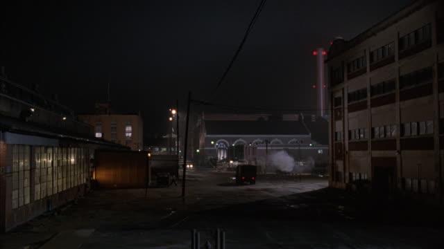 vídeos y material grabado en eventos de stock de pan-left of a warehouse in an industrial area. - soledad