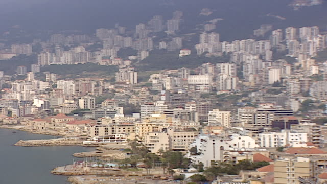 pan-left of jounieh and ghadir in the keserwan district of lebanon. - cityscape stock videos & royalty-free footage