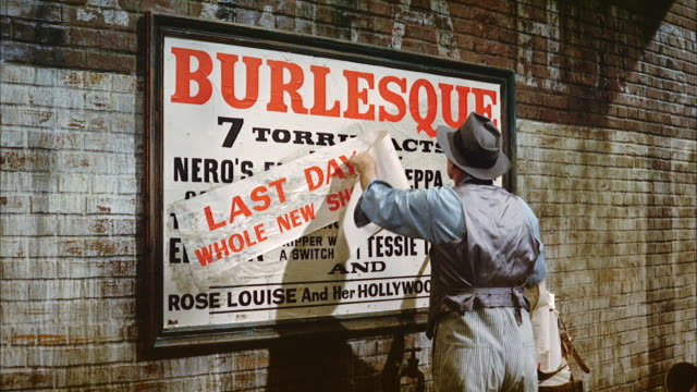 ms panman sticking last day today sign poster on  burlesque theater billboard  - poster stock-videos und b-roll-filmmaterial