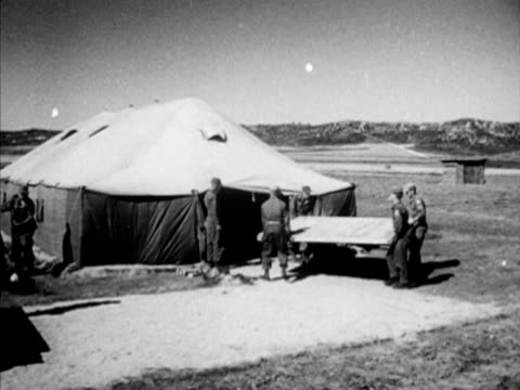 panmunjom village soldiers carrying table top into tent us admiral c turner joy arriving w/ others ms lt general namil la tu ws photographers taking... - 1951 bildbanksvideor och videomaterial från bakom kulisserna