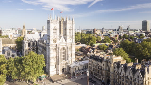 panned tl from westminster abbey to the houses of parliament, london - westminster abbey stock-videos und b-roll-filmmaterial
