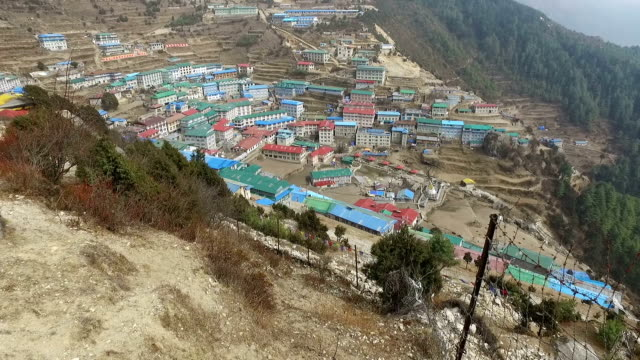 panned view of namche bazar in nepal - mt everest national park stock videos and b-roll footage