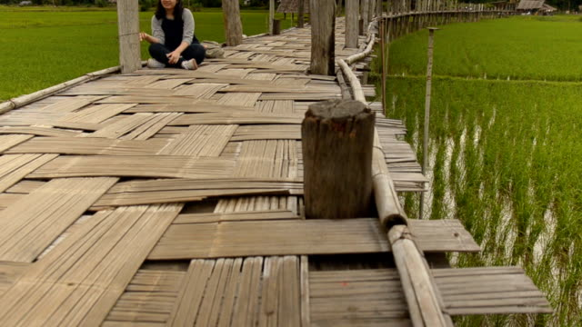 panning: a young women relax on floor of su tong pae - mae hong son province stock videos and b-roll footage