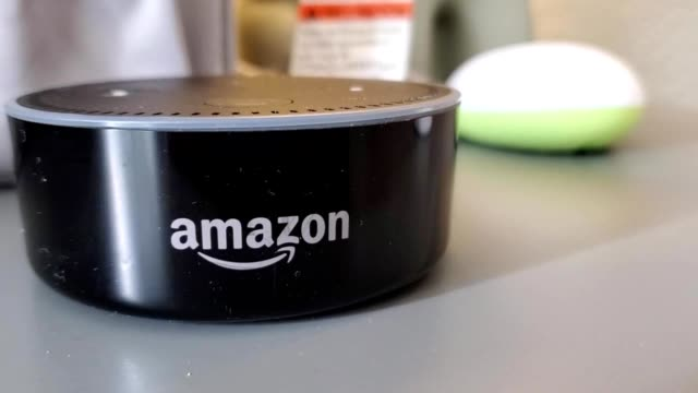 panning across amazon echo dot smart speaker from amazon with logo visible in a smart home in san ramon california september 6 2019 - logo stock videos & royalty-free footage