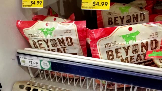 panning across beyond meat frozen plantbased hightech meat substitute in freezer section of a grocery store in san ramon california october 8 2019 - meat stock videos & royalty-free footage