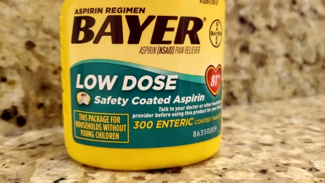 panning across bottle of baby aspirin from bayer commonly used in pain relief and often prescribe as a preventative measure for various inflammatory... - aspirin stock videos & royalty-free footage