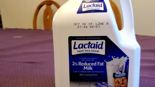 panning across bottle of lactaid milk, a lactose free milk designed for people with the lactose intolerance food allergy, a brand of parent company... - lactose fermentation stock videos & royalty-free footage