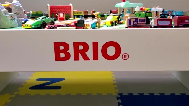panning across child's toy train table from swedish wooden toy company brio in child's nursery; panning up to train track setup atop table, san... - nursery bedroom stock videos & royalty-free footage