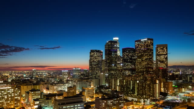 vídeos de stock, filmes e b-roll de panning across downtown los angeles from above between day and night - time lapse do dia para a noite