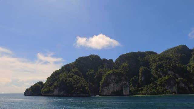 panning across dramatic island landscape in thailand - anchored stock videos & royalty-free footage