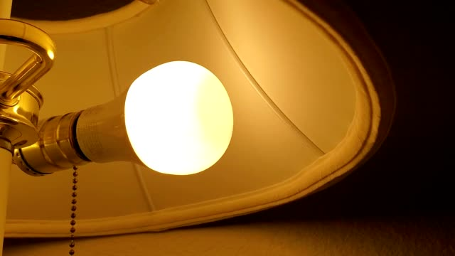 panning across light emitting diode energy efficient lightbulb in antique lamp, san ramon california, january 2, 2020. - energy efficient lightbulb stock videos & royalty-free footage