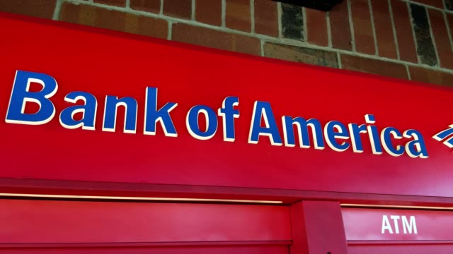 panning across logo for bank of america down to the kiosk of a bank of america automated teller machine november 28 2017 - bank of america stock videos & royalty-free footage