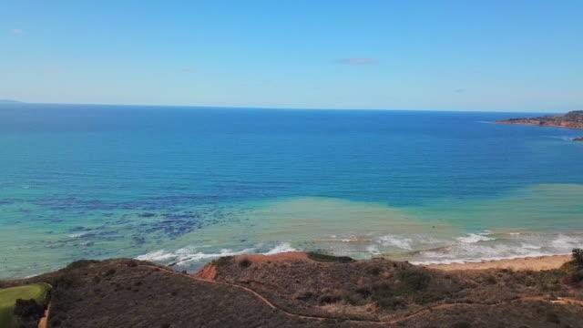 panning across shore towards blue pacific ocean - palos verdes stock videos & royalty-free footage
