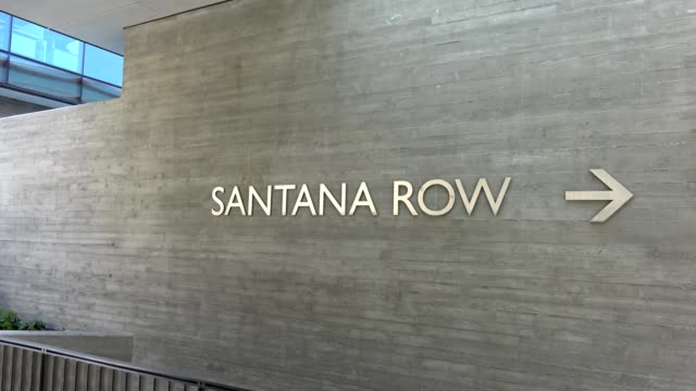 panning across sign with directional arrow on a concrete wall reading santana row, on santana row, a luxury outdoor shopping mall in the silicon... - concrete wall stock videos & royalty-free footage