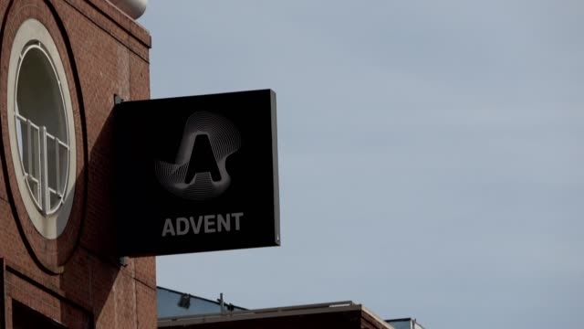 panning across sign with logo on facade at office of software company advent in the south of market neighborhood of san francisco california june 10... - advent stock videos & royalty-free footage