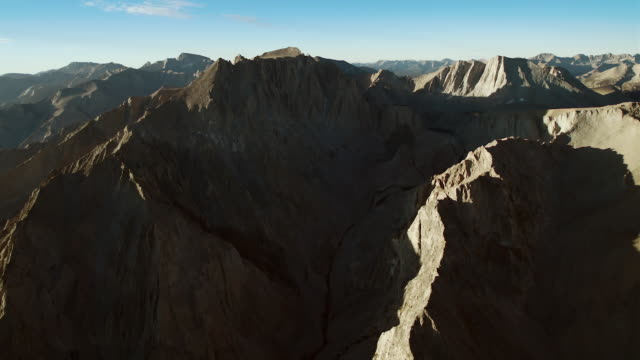 panning across the sierra crest, with the distinctive mount tyndall in the mid-ground, aerial view. - basin and range province stock videos and b-roll footage