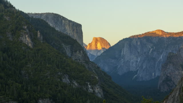 panning across yosemite national park at sunset - half dome stock videos & royalty-free footage