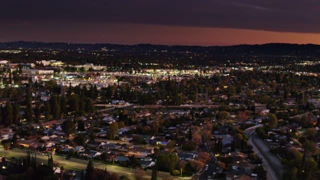 panning aerial of northridge, los angeles at dusk - northridge stock videos & royalty-free footage