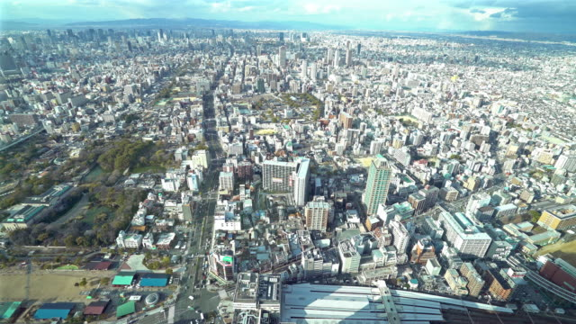 panning aerial osaka cityscape from tennoji in action - osaka stock videos and b-roll footage