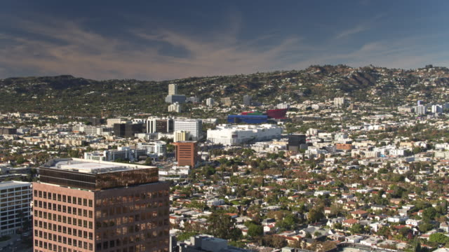 panning aerial shot of beverly grove, los angeles, with west hollywood behind - grove stock videos and b-roll footage