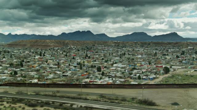 panning aerial shot of us/mexico border wall near el paso and anapra, ciudad juárez - mexico stock videos & royalty-free footage