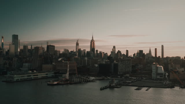 panning aerial shot showing midtown manhattan at sunrise, new york city, united states of america - midtown manhattan stock videos & royalty-free footage