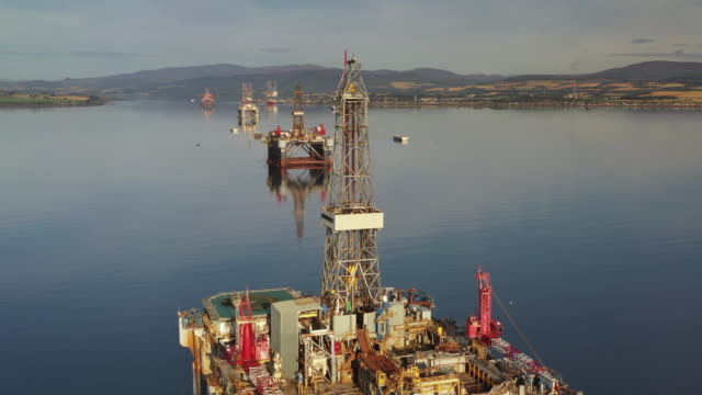 panning aerial shot showing offshore drilling platforms, cromarty firth, scotland, united kingdom - bay of water stock videos & royalty-free footage